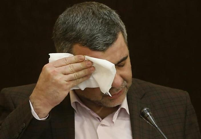 Iranian Deputy Health Minister Iraj Harirchi wipes the sweat off his face during a February 2020 news conference before testing positive for the novel coronavirus (AFP Photo/MEHDI BOLOURIAN)