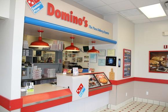 Domino's storefront lobby with signage, logo, and products.