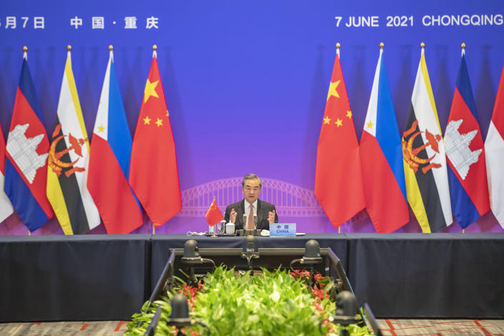 In this photo released by Xinhua News Agency, Chinese State Councilor and Foreign Minister Wang Yi speaks during a special ASEAN-China Foreign Ministers' Meeting in Celebration of the 30th Anniversary of Dialogue Relations attended by foreign ministers from ASEAN countries, in Chongqing, southwestern China, Monday, June 7, 2021. China is hosting foreign ministers from 10 Southeast Asian nations this week in the southwestern megacity of Chongqing amid heightened competition between Beijing and Washington for influence in the region. (Wang Quanchao/Xinhua via AP)