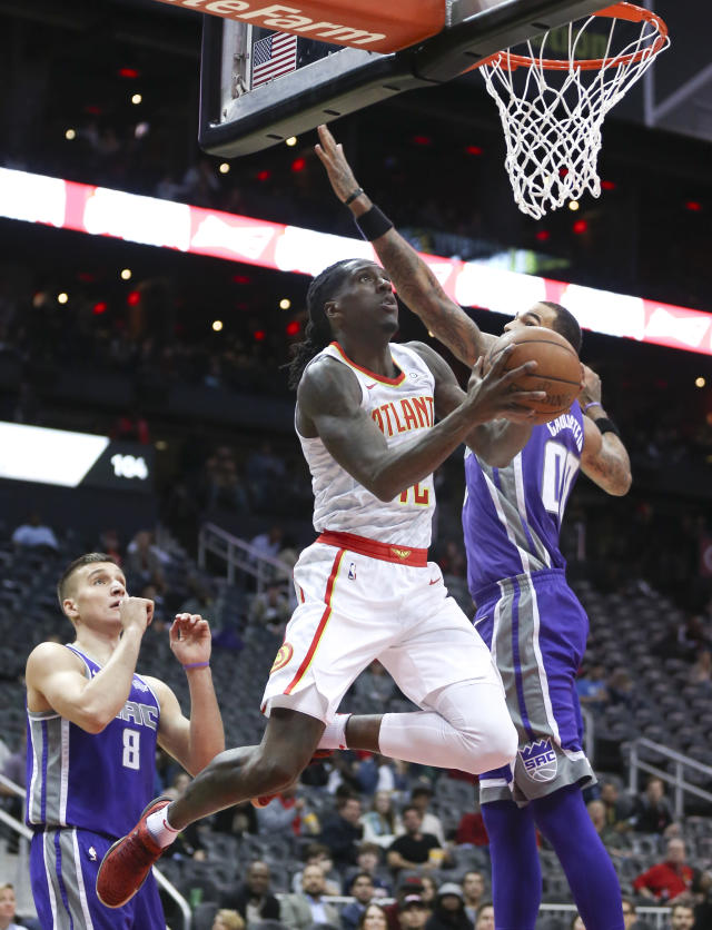 Atlanta Hawks forward Taurean Prince, left, scores as Sacramento Kings center Willie Cauley-Stein, right, defends during the first half of an NBA basketball game Wednesday, Nov. 15, 2017, in Atlanta. (AP Photo/John Bazemore)
