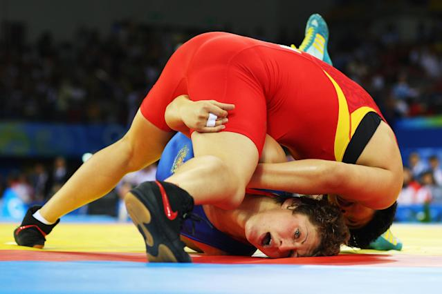 BEIJING - AUGUST 17: Wang Jiao of China competes in the Women's Freestyle 72 kg Final against Stanka Slateva of Bulgaria held at the China Agriculture University Gymnasium on Day 9 of the Beijing 2008 Olympic Games on August 17, 2008 in Beijing, China. (Photo by Phil Walter/Getty Images)