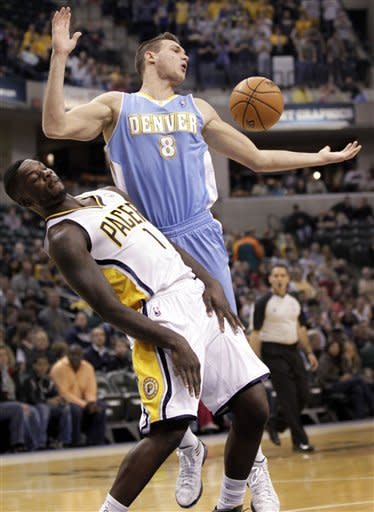 Denver Nuggets forward Danilo Gallinari, right, of Italy, loses the ball after dribbling into Indiana Pacers guard Lance Stephenson during the first half of an NBA basketball game in Indianapolis, Friday, Dec. 7, 2012. (AP Photo/AJ Mast)
