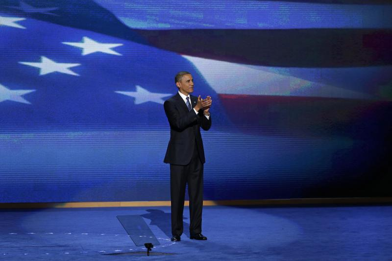 President Barack Obama stands on stage after addressing the Democratic National Convention in Charlotte, N.C., on Thursday, Sept. 6, 2012. (AP Photo/J. Scott Applewhite)
