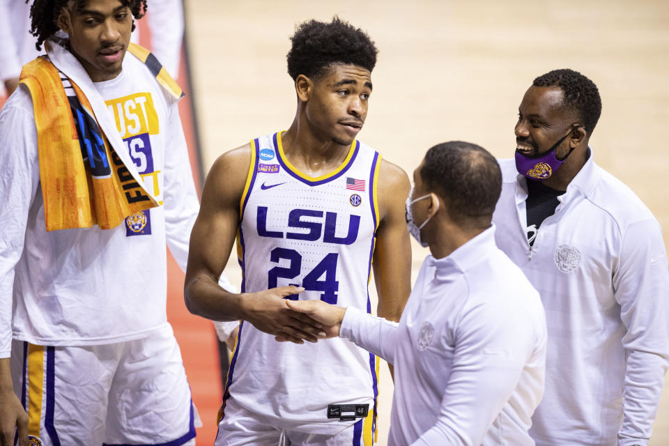 LSU guard Cameron Thomas (24) reacts to the team's win over St. Bonaventure as he leaves the court after a first round game in the NCAA men's college basketball tournament, Saturday, March 20, 2021, at Assembly Hall in Bloomington, Ind. (AP Photo/Doug McSchooler)