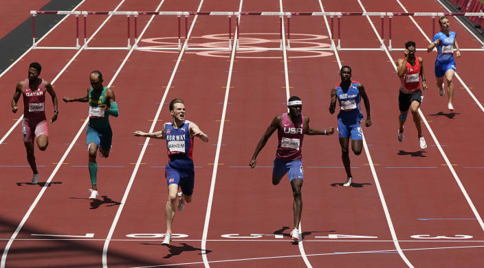 Karsten Warholm, of Norway, third left, celebrates as he wins the gold medal ahead of Rai Benjamin, of United States in the final of the men's 400-meter hurdles at the 2020 Summer Olympics, Tuesday, Aug. 3, 2021, in Tokyo, Japan. (AP Photo/Charlie Riedel)