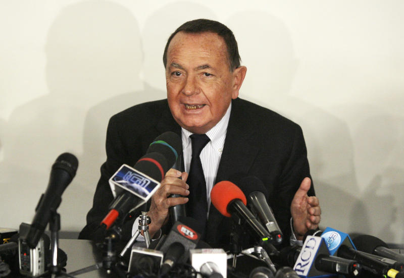 Paolo Bonaiuti, spokesman for the Italy's Prime Minister Silvio Berlusconi, speaks during a news conference at the San Raffaele Hospital where Berlusconi was hospitalized in Milan December 14, 2009. REUTERS/Alessandro Garofalo (ITALY - Tags: POLITICS CIVIL UNREST)