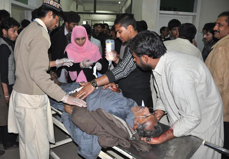 Pakistani hospital staff treat a person injured in a suicide attack on Shiite mourners in Rawalpindi, Pakistan on Wednesday, Nov. 21, 2012. A suicide bomber had tried to enter a procession near a Shiite mosque, where the bomber detonated the explosives after being stopped by security forces killing scores of people and left many wounded, police officials said. (AP Photo/C.A. Hussain)