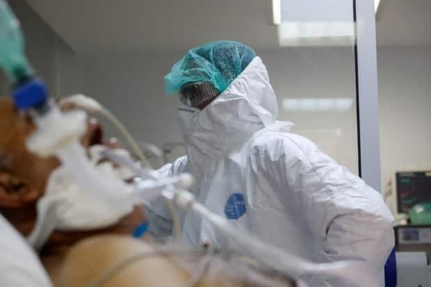 With hospitalizations due to COVID-19 setting new daily records in B.C., the health minister announced on Thursday the province would postpone 1,750 non-urgent surgeries over the next two weeks. (Giorgos Moutafis/Reuters - image credit)