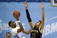 North Carolina forward Garrison Brooks (15) shoots while College of Charleston forward Lorenzo Edwards (21) defends during the second half of an NCAA college basketball game in Chapel Hill, N.C., Wednesday, Nov. 25, 2020. (AP Photo/Gerry Broome)