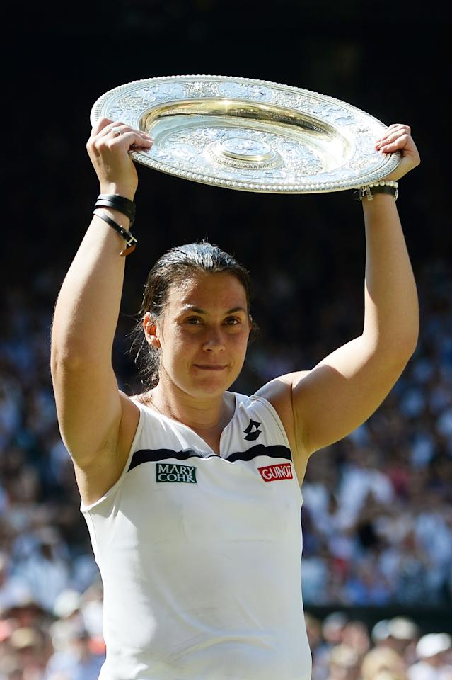 LONDON, ENGLAND - JULY 06: Marion Bartoli of France poses with the Venus Rosewater Dish trophy after her victory in the Ladies' Singles final match against Sabine Lisicki of Germany on day twelve of the Wimbledon Lawn Tennis Championships at the All England Lawn Tennis and Croquet Club on July 6, 2013 in London, England. (Photo by Dennis Grombkowski/Getty Images)