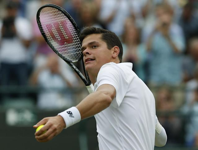 Milos Raonic of Canada tosses the ball to the crowd after defeating Nick Kyrgios of Australia in their men's singles quarterfinal match at the All England Lawn Tennis Championships in Wimbledon, London, Wednesday, July 2, 2014. (AP Photo/Ben Curtis)