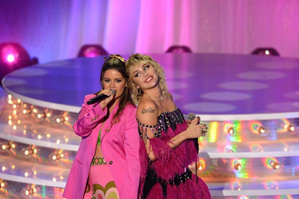"""Maren Morris (left) and Miley Cyrus perform during """"Miley Cyrus Presents Stand By You,"""" a Pride Month special filmed at the Ryman Auditorium in Nashville, Tennessee."""