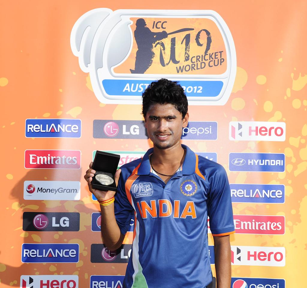 TOWNSVILLE, AUSTRALIA - AUGUST 16:  Ravikant Singh of India with the Man of the Match award at the end of the  ICC U19 Cricket World Cup 2012 match between India and PNG at Endeavour Park on August 16, 2012 in Townsville, Australia.  (Photo by Ian Hitchcock-ICC/Getty Images)