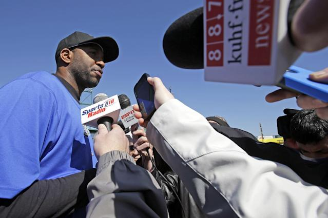 Retired NBA All-Star Tracy McGrady faces the media at the Sugar Land Skeeters baseball stadium Wednesday, Feb. 12, 2014, in Sugar Land, Texas. McGrady hopes to tryout for the independent Atlantic League Skeeters. (AP Photo/Pat Sullivan)