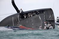 American Magic capsizes during the America's Cup challenger series on Sunday