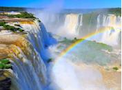 """<p>One of the seven new natural wonders of the world, these <a href=""""https://www.purewow.com/travel/best-waterfalls-in-the-world"""" rel=""""nofollow noopener"""" target=""""_blank"""" data-ylk=""""slk:incredible waterfalls"""" class=""""link rapid-noclick-resp"""">incredible waterfalls</a> frame the Argentina-Brazil border. Together they make up the largest system of waterfalls in the world, and you won't be able to look without losing your breath.</p>"""