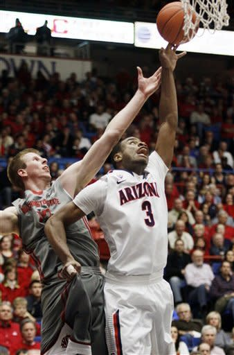 Arizona's Kevin Parrom (3) and Washington State's Brock Motum (12) battle for the rebound during the first half of an NCAA college basketball game in Tucson, Ariz., Thursday, Jan. 26, 2012. (AP Photo/Wily Low)