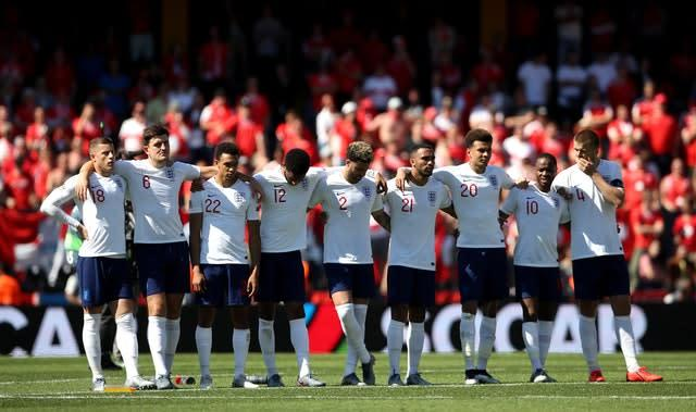 England players line up ahead of the shoot-out (Tim Goode/PA)