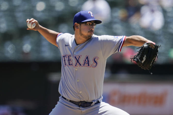 Texas Rangers' Dane Dunning pitches against the Oakland Athletics during the first inning of a baseball game in Oakland, Calif., Thursday, July 1, 2021. (AP Photo/Jeff Chiu)