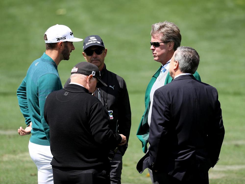 Johnson talks to Augusta National member Fred Ridley (2nd R) (Getty)
