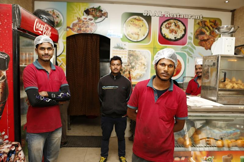 Cooks and waiters pose at the Zaiqa restaurant in southern suburbs of the Qatari capital Doha on March 31, 2015 (AFP Photo/Karim Jaafar)
