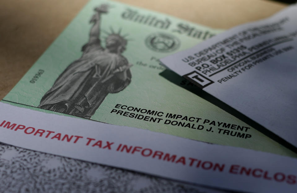 President Donald J.Trump's name is printed on a stimulus check issued by the IRS to help combat the adverse economic effects of the COVID-19 outbreak, Thursday, April 23, 2020, in  San Antonio. According to the Treasury Department, it marks the first time a president's name has appeared on any IRS payments, whether refund checks or other stimulus checks that have been mailed during past economic crises. (AP Photo/Eric Gay)