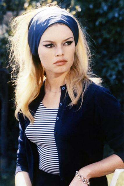 """<em><h2>Le Mepris (1963)</h2></em><br>Like Marilyn Monroe, Brigitte Bardot was a capable and nuanced actress all too often slotted into the role of blonde bubblehead. In this Jean-Luc Godard film (also known as <em>Contempt</em>), she found a role worthy of her chops as a woman who loses respect for her novelist husband when he accepts an assignment to punch up a hacky screenplay. Watch it for Bardot's resplendent, pouty disdain, and her wardrobe of pared-down basics that define French chic.<span class=""""copyright"""">Photo: Courtesy of Lions Gate.</span>"""