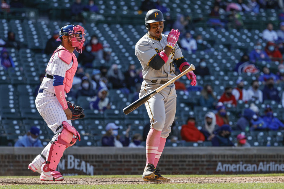 Pittsburgh Pirates' Wilmer Difo, right, reacts after striking out off Chicago Cubs relief pitcher Jason Adam (not shown) during the ninth inning of a baseball game, Sunday, May 9, 2021, in Chicago. (AP Photo/Kamil Krzaczynski)