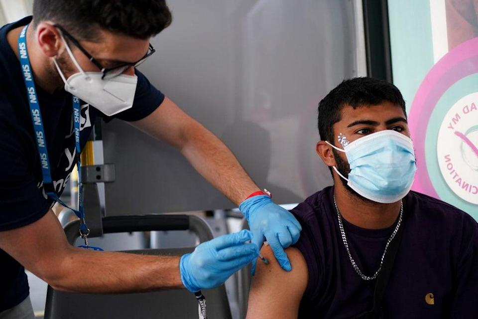 Festival goer Miles Moss receives a vaccine dose at a Covid-19 vaccination bus at Latitude festival in Henham Park, Southwold (Jacob King/PA) (PA Wire)
