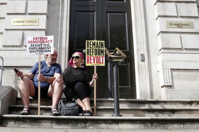 Anti-Brexit protesters from 'Stop the Coup' movement demonstrate near Downing Street in London, Saturday, Aug. 31, 2019. Political opposition to Prime Minister Boris Johnson's move to suspend Parliament is crystalizing, with protests around Britain and a petition to block the move gaining more than 1 million signatures. (AP Photo/Alastair Grant)
