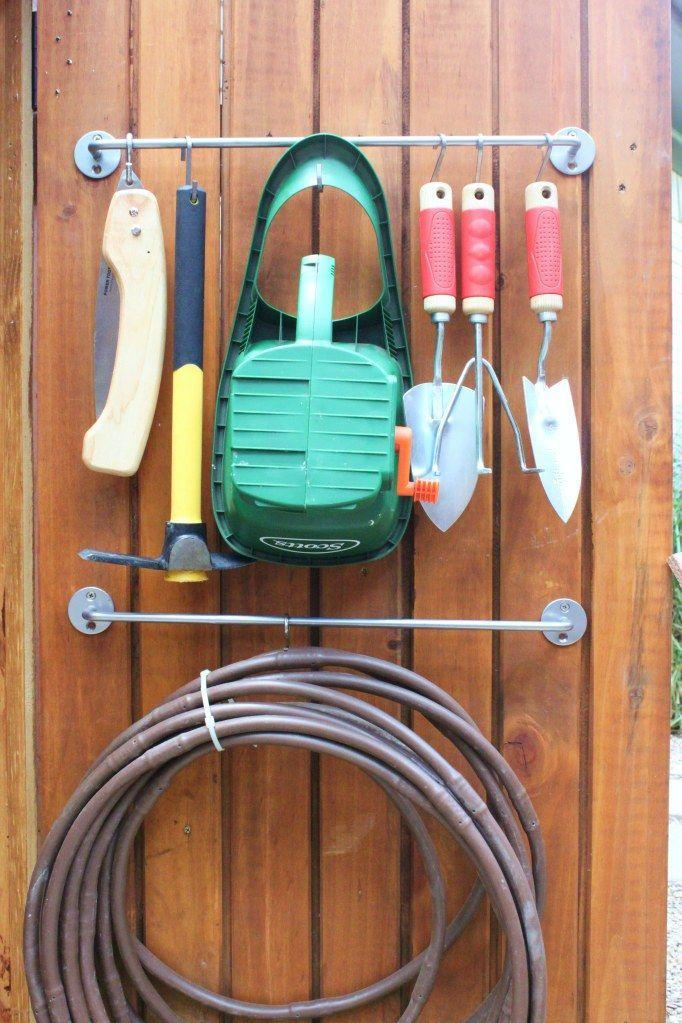 """<p>Make better use of your shed's doors by hanging everything from spades to the garden hose with a towel bar. </p><p><a href=""""http://thecavenderdiary.com/2013/07/23/tool-shed-updates/"""" rel=""""nofollow noopener"""" target=""""_blank"""" data-ylk=""""slk:Get the tutorial at The Cavender Diary »"""" class=""""link rapid-noclick-resp""""><em>Get the tutorial at The Cavender Diary »</em></a></p>"""