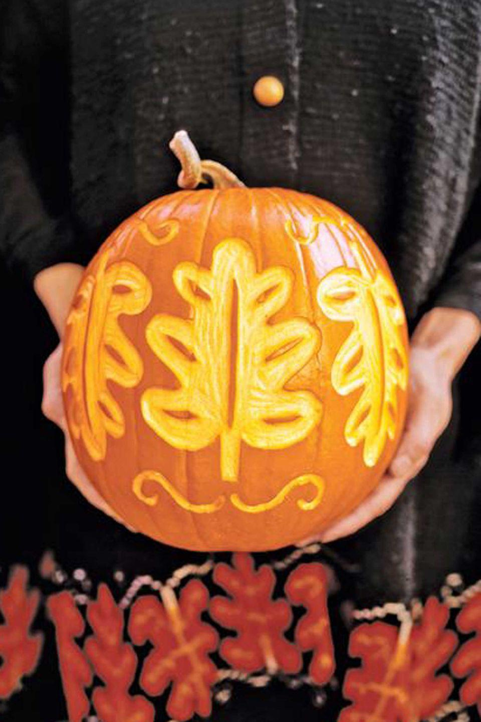 <p>A shallow leaf pattern is the perfect seasonal motif for this pumpkin. Use a linoleum cutter to cut out the design, leaving small pieces to suggest leaf veins.</p><p><strong>TIP:</strong> Don't hollow out the pumpkin if you don't want to illuminate it.</p>