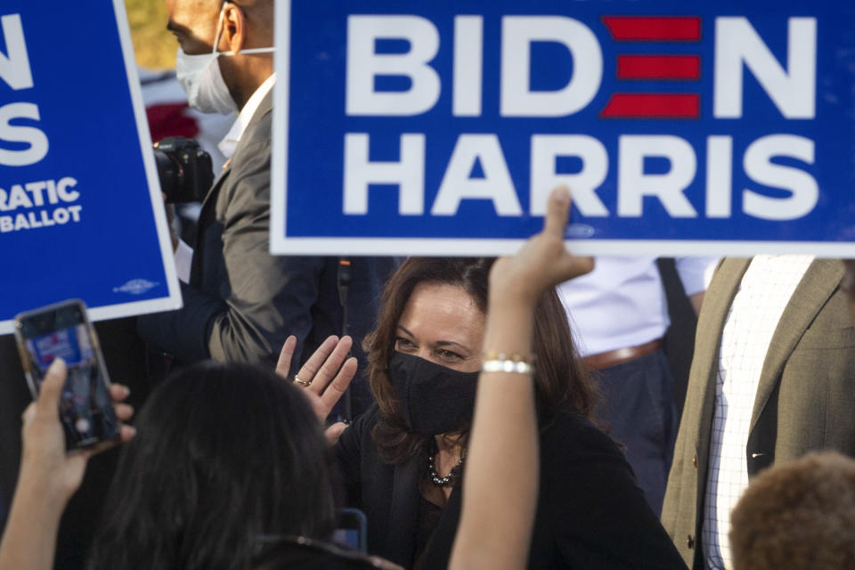 Democratic vice presidential candidate Sen. Kamala Harris, D-Calif., interacts with supporters during a campaign event at Morehouse College, Friday, Oct. 23, 2020, in Atlanta. (AP Photo/John Amis)