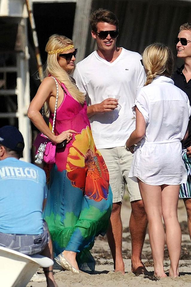 """While exotic trips are definitely nice, this year it seems as if a lot of celebs are staying closer to home. Of course, when you have a beach house along the sunny (and pricey!) shores of Malibu, California, like Paris Hilton, every day is a vacation! <a href=""""http://www.splashnewsonline.com"""" target=""""new"""">Splash News</a> - July 30, 2011"""