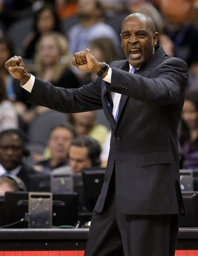 Atlanta Hawks head coach Larry Drew calls a play against the Phoenix Suns during the first half of an NBA basketball game, Friday, March 1, 2013, in Phoenix. (AP Photo/Matt York)