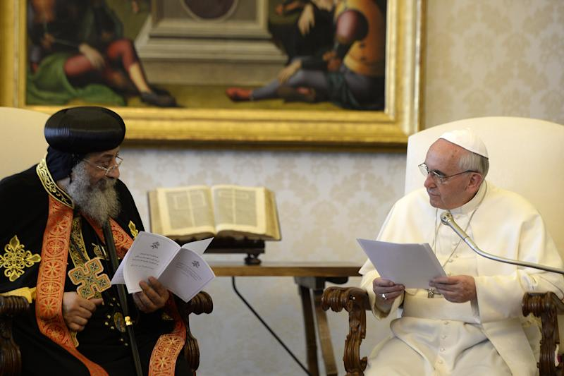 Pope Francis, right, listens to Coptic Orthodox Church of Egypt Pope Tawadros II during their private audience in the pontiff's library, at the Vatican, Friday, May 10, 2013. The head of the Coptic Orthodox Church of Egypt, Pope Tawadros II, called on Pope Francis on Friday in the first such meeting in 40 years. The occasion was to mark the anniversary of the signing of a declaration for improving ties between the two churches between Pope Paul VI and Tawadros' predecessor, Pope Shenouda III. (AP Photo/Andreas Solaro, pool)