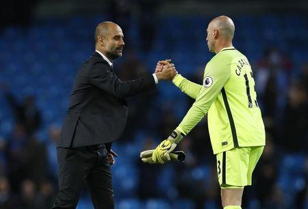 Britain Soccer Football - Manchester City v Manchester United - Premier League - Etihad Stadium - 27/4/17 Manchester City's Willy Caballero with manager Pep Guardiola at the end of the match Action Images via Reuters / Jason Cairnduff Livepic