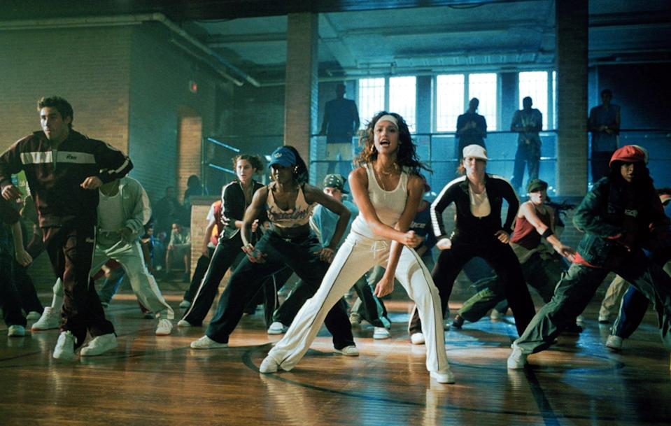 """<p><a class=""""link rapid-noclick-resp"""" href=""""https://www.popsugar.com/Jessica-Alba"""" rel=""""nofollow noopener"""" target=""""_blank"""" data-ylk=""""slk:Jessica Alba"""">Jessica Alba</a>'s role as choreographer Honey Daniels in 2003's <strong>Honey</strong> brought about this all-white outfit complete with a gold cross and nameplate necklace. While I love the sweats with sneakers and a ribbed white tank, Honey owned the full tracksuit set.</p>"""
