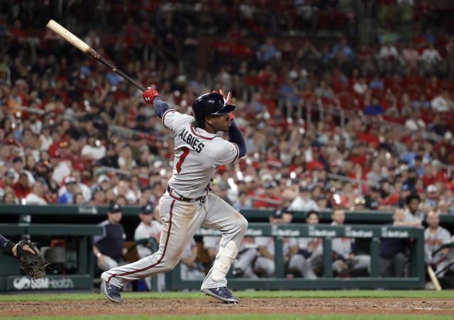 Atlanta Braves' Ozzie Albies watches his RBI single during the ninth inning of a baseball game against the St. Louis Cardinals Sunday, May 26, 2019, in St. Louis. Albies was tagged out trying to make it to second. (AP Photo/Jeff Roberson)