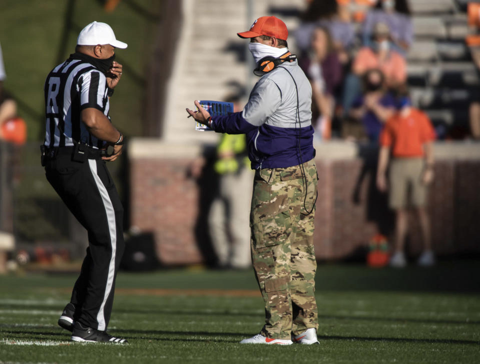 Clemson head coach Dabo Swinney talks to an official during the first half of an NCAA college football game against Pittsburgh Saturday, Nov. 28, 2020, in Clemson, S.C. (Ken Ruinard/Pool Photo via AP)