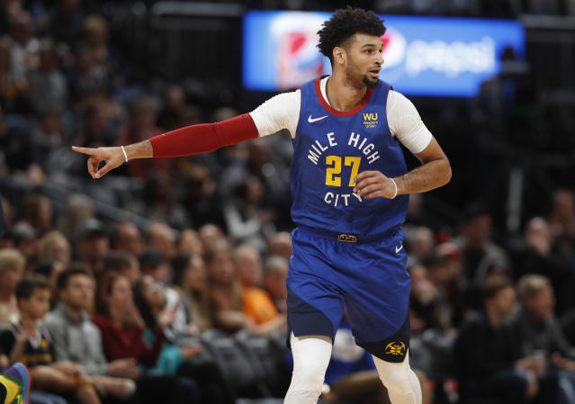 Denver Nuggets guard Jamal Murray directs his teammates as he drops back to defend against the Minnesota Timberwolves in the first half of an NBA basketball game Friday, Dec. 20, 2019, in Denver. (AP Photo/David Zalubowski)