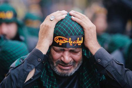 A Lebanon's Hezbollah supporter mourns Imam Hussein during last day of Ashura, Beirut, Lebanon September 20, 2018. REUTERS/Aziz Taher