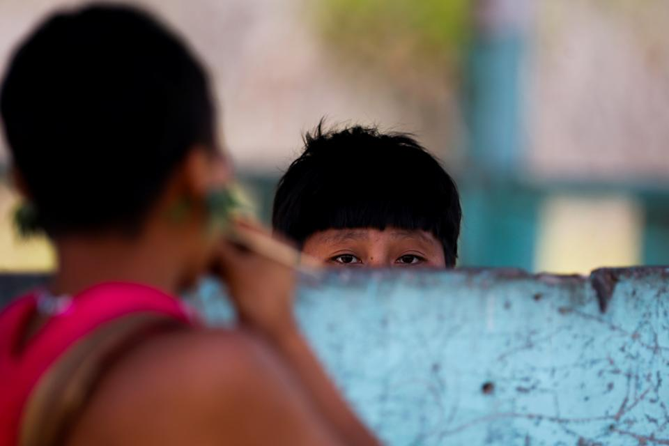 A girl from the indigenous Yanomami ethnic group looks on, amid the spread of the coronavirus disease (COVID-19), at the 4th Surucucu Special Frontier Platoon of the Brazilian army in the municipality of Alto Alegre, state of Roraima, Brazil July 1, 2020. REUTERS/Adriano Machado