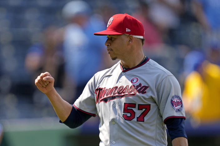 Minnesota Twins relief pitcher Hansel Robles celebrates after a baseball game against the Kansas City Royals Sunday, July 4, 2021, in Kansas City, Mo. The Twins won 6-2. (AP Photo/Charlie Riedel)