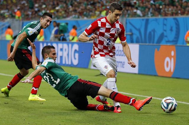 Mexico's Paul Aguilar fights for the ball with Croatia's Sime Vrsaljko during the group A World Cup soccer match between Croatia and Mexico at the Arena Pernambuco in Recife, Brazil, Monday, June 23, 2014. (AP Photo/Eduardo Verdugo)