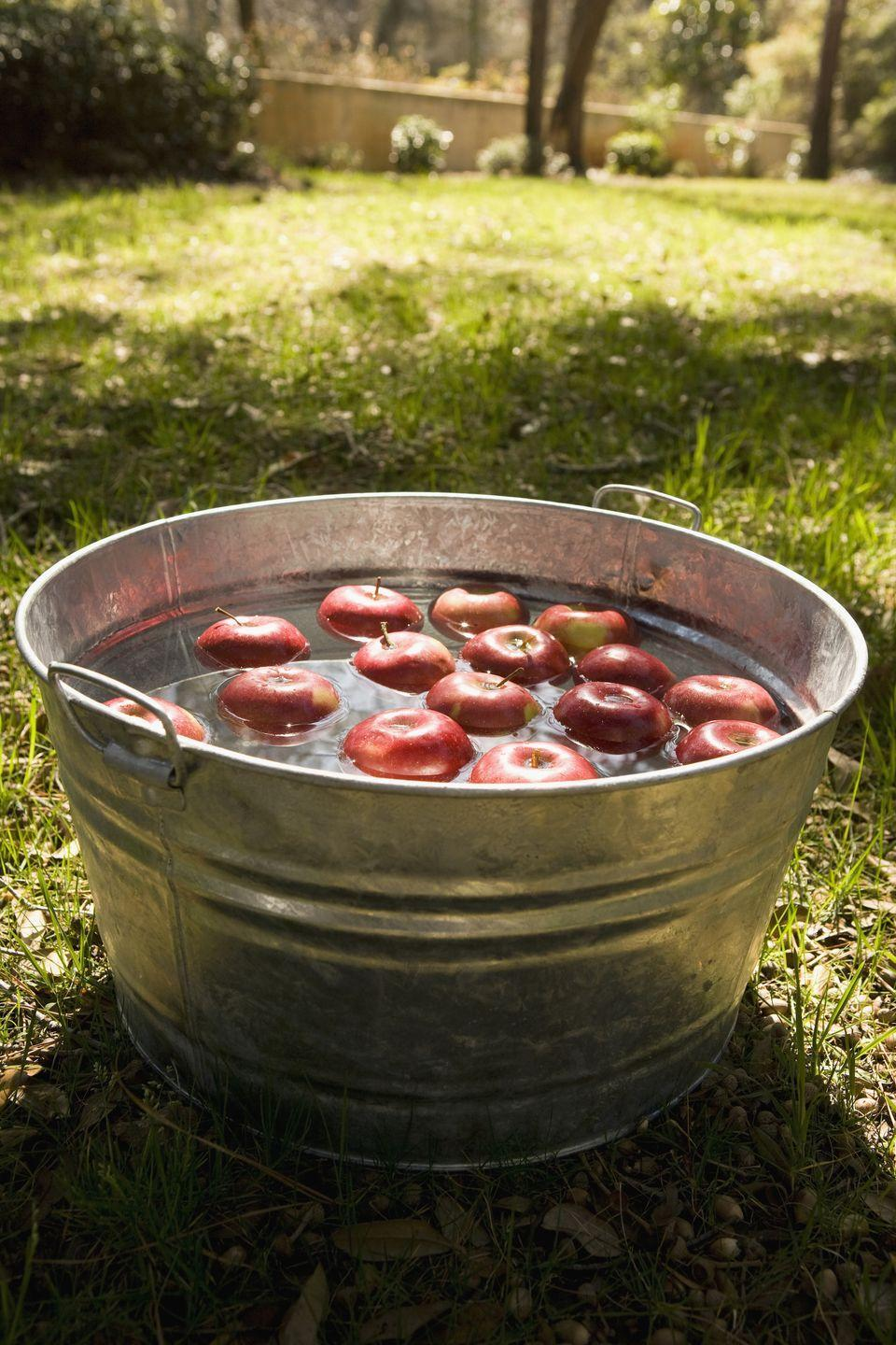 "<p>Bobbing for apples has been a longtime Halloween tradition. All you need is a clean tub, water, and—you guessed it—apples. (Bonus points if they are fresh from an apple-picking excursion!)</p><p><a class=""link rapid-noclick-resp"" href=""https://www.amazon.com/Behrens-15-Gallon-Round-Steel-Tub/dp/B0014CR8EE/?tag=syn-yahoo-20&ascsubtag=%5Bartid%7C2139.g.34440360%5Bsrc%7Cyahoo-us"" rel=""nofollow noopener"" target=""_blank"" data-ylk=""slk:SHOP TUBS"">SHOP TUBS</a></p>"