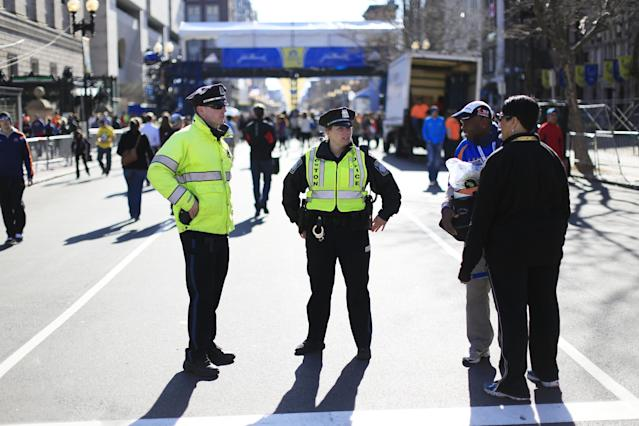Police stand by near the finish line ahead of Monday's 118th Boston Marathon, Sunday, April 20, 2014, in Boston. Massachusetts Gov. Deval Patrick says officials are striking a balance between more security and maintaining the city's festive spirit. (AP Photo/Matt Rourke)