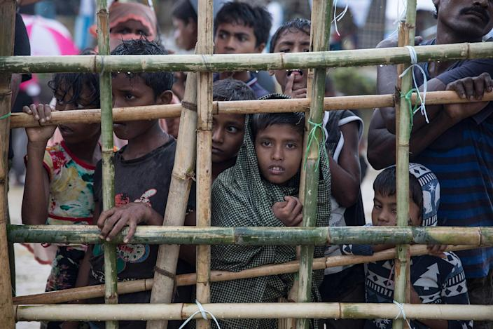 <p>Children wait for hot food given out by a Turkish aid group on October 13, at Palongkhali refugee camp, Cox's Bazar, Bangladesh. (Photograph by Paula Bronstein/Getty Images) </p>