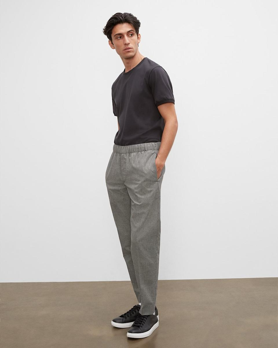 Model wears Patterned Elasticated Trousers in grey check. Image via Club Monaco.