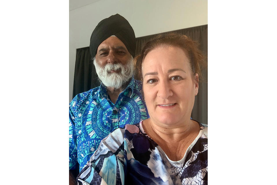 In this photo provided by Sandy Price, Price and her husband, Pal Ahluwalia, pose for a photo in Brisbane, Australia, Friday, Feb. 5, 2021. Ahluwalia, the leader of the University of the South Pacific, and his wife were asleep Wednesday at their Fiji home when a ruckus outside awoke them near midnight. About 15 plain-clothed government agents had surrounded their house in the capital Suva and gave them minutes to pack before they were hastily deported to Australia. (Sandy Price via AP)